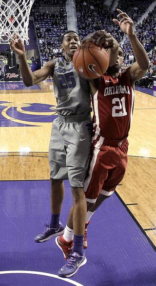 Kansas State's Wesley Iwundu (25) and Oklahoma's Cameron Clark (21) viefor a rebound during the first half of an NCAA college basketball game Tuesday, Jan. 14, 2014, in Manhattan, Kan. (AP Photo/Charlie Riedel)