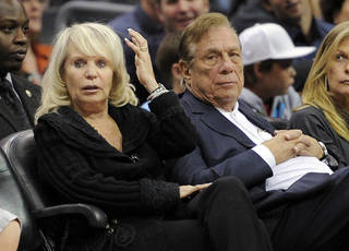 FILE - In this Nov. 12, 2010, file photo, Shelly Sterling sits with her husband, Donald Sterling, during the Los Angeles Clippers' NBA basketball game against the Detroit Pistons in Los Angeles. Only final arguments and a ruling remain in the trial to determine whether Sterling's estranged wife can sell the Clippers to former Microsoft CEO Steve Ballmer for $2 billion. Lawyers for Sterling plan to argue Monday, July 28, 2014, that Shelly Sterling had no right to make the deal with Ballmer, even though Donald Sterling had given her written authority to pursue a sale. (AP Photo/Mark J. Terrill, File)
