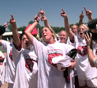 Members of the Oklahoma women's softball team acknowledge their fans after defeating UCLA 3-1 in the championship game of the NCAA Women's College World Series in Oklahoma City, on Monday, May 29, 2000. (AP Photo/Jackson Laizure)