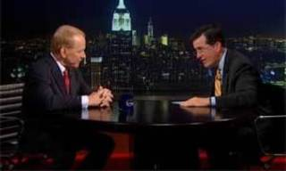 Screen image of Gary England with Stephen Colbert on The Colbert Report Wednesday, Sept. 4, 2013.