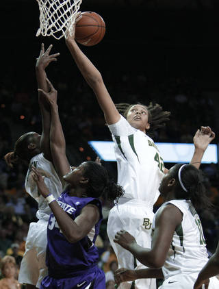 Baylor center Brittney Griner, top right, comes down with a defensive rebound in the first half over Kansas St. forward Branshea Brown (34) in the first half of an NCAA college basketball game, Wednesday, Feb. 23, 2011, in Waco, Texas. No. 3 Baylor won 75-48. (AP Photo/Tony Gutierrez)