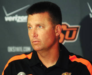 OKLAHOMA STATE UNIVERSITY / OSU / COLLEGE FOOTBALL: Oklahoma State coach Mike Gundy speaks to media members at the media luncheon on August 22, 2013 at Boone Pickens Stadium in Stillwater, Okla. Photo by KT King, For the Oklahoman