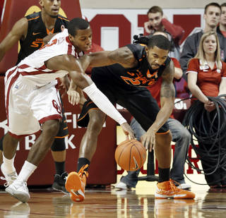 Sooner's Buddy Hield, left, and Cowboy's Michael Cobbins fight for a ball under the basket as the University of Oklahoma Sooners (OU) play the Oklahoma State Cowboys (OSU) in NCAA, men's college basketball at The Lloyd Noble Center on Saturday, Jan. 12, 2013 in Norman, Okla. Photo by Steve Sisney, The Oklahoman