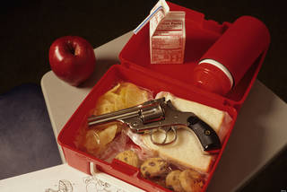 ATCNG0 Hand gun in opened lunch pail at school during lunch time showing the problem with school violence