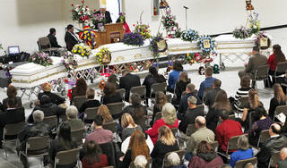 Friends and family members look on at the caskets of Summer Rust and her four children, Kirsten, Autumn and Teagin Rust and Evynn Garas, in El Reno on Wednesday. PHOTOS BY CHRIS LANDSBERGER, THE OKLAHOMAN