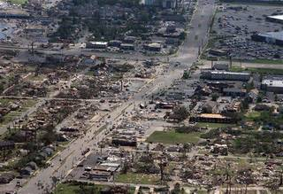 This aerial photo shows the devastation of the Cedar Crest and Forest Lake neighborhoods in Tuscaloosa, Ala. on Thursday, April 28, 2011. A powerful and deadly tornado cut through Tuscaloosa Wednesday evening. President Barack Obama said he would visit Alabama Friday to view damage and meet with the governor and families devastated by the storms. Obama has already expressed condolences by phone to Gov. Robert Bentley and approved his request for emergency federal assistance. (AP Photo/The Tuscaloosa News, Dusty Compton)