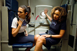 "Tamara Tunie, right, and Nadine Velazquez in a scene from ""Flight."" PARAMOUNT PICTURES PHOTO"