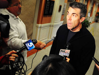 ESPN analyst Chris Fowler speaks with media members during a pool interview the day before College Gameday will broadcast Oklahoma State's library lawn on Saturday, November 23, 2014. Photo by KT King/For the Tulsa World