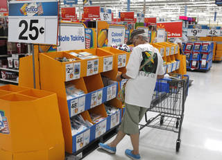 Shoppers make purchases at the Walmart store Tuesday at 100 E. I-240 Service Road in south Oklahoma City. This upcoming weekend will be sales tax free for purchases involving back-to-school supplies. Photo by Paul Hellstern, The Oklahoman PAUL HELLSTERN - Oklahoman