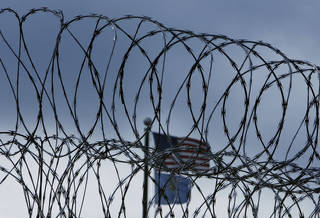 A security fence at the Joseph Harp Correctional Center in Lexington, OK., PHOTO BY SARAH PHIPPS, THE OKLAHOMAN ARCHIVES SARAH PHIPPS