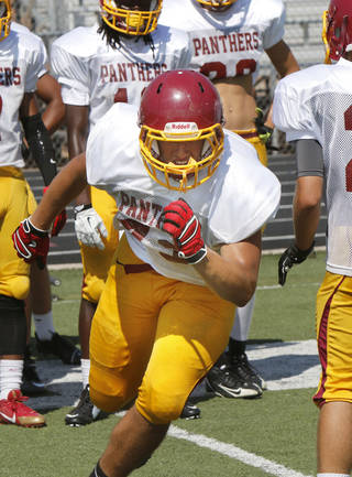 Logan Price participates in morning practice at Putnam City North High School in Oklahoma City, OK, Monday, August 18, 2014, Photo by Paul Hellstern, The Oklahoman