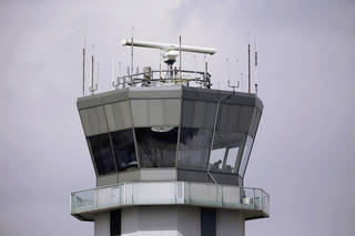 The Federal Aviation Administration has decided to close 149 air traffic control towers at small airports throughout the country. The FAA also is studying shifts at airport towers such as this one at Chicago's Midway International Airport. (AP Photo)
