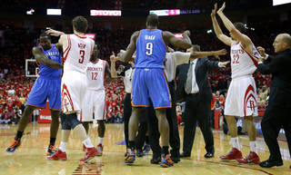 NBA BASKETBALL: Oklahoma City's Kendrick Perkins, left and Houston's Francisco Garcia cause an argument between the two teams during Game 6 in the first round of the NBA playoffs between the Oklahoma City Thunder and the Houston Rockets at the Toyota Center in Houston, Texas, Friday, May 3, 2013. Photo by Bryan Terry, The Oklahoman