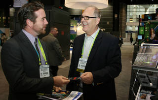 Tom Kupiec from DNA Solutions greets a visitor at last year's Biotechnology Industry Organization annual convention. PHOTO PROVIDED unknown - PROVIDED