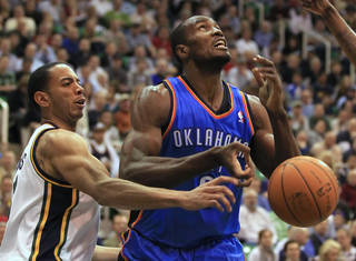 Oklahoma City Thunder's Serge Ibaka, right, has the ball stripped by Utah Jazz's Devin Harris during the first half of an NBA basketball game in Salt Lake City, Tuesday, March 20, 2012. (AP photo/George Frey) ORG XMIT: UTGF105