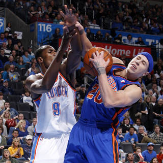 Oklahoma City's Serge Ibaka (9) fights for the ball with New York's Mike Bibby (20) during the NBA game between the Oklahoma City Thunder and the New York Knicks at Chesapeake Energy Arena in Oklahoma CIty, Saturday, Jan. 14, 2012. Photo by Bryan Terry, The Oklahoman