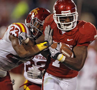 Oklahoma's DeMarco Murray (7) is hit by Iowa State's Leonard Johnson (23) during the first half of the college football game between the University of Oklahoma Sooners (OU) and the Iowa State Cyclones (ISU) at the Glaylord Family-Oklahoma Memorial Stadium on Saturday, Oct. 16, 2010, in Norman, Okla. Photo by Chris Landsberger, The Oklahoman