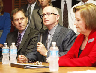 Oklahoma City school Superintendent Karl Springer, left, Edmond school Superintendent David Goin, and Union Public Schools Superintendent Cathy Burden speak during a meeting in Oklahoma City on Thursday. The officials expressed concern and frustration about the A to F school evaluation reform. Photo by Paul Hellstern, The Oklahoman