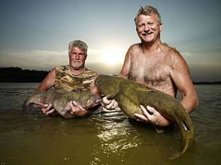 Trent Jackson, left, and Skipper Bivins of Temple star in a new television show, Hillbilly Handfishin', which features noodling for flatheads in southern Oklahoma. The show debuts Aug. 7 on Animal Planet. Photo provided by David Yellen