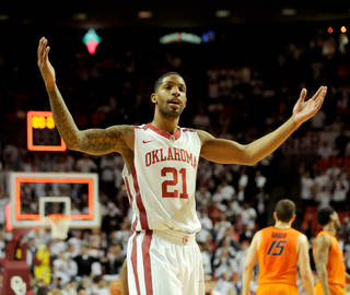 Oklahoma forward Cameron Clark gestures in celebration after an NCAA college basketball game in Norman, Okla., Monday, Jan. 27, 2014. Clark had 6 rebounds in the in the 88-76 win over rival Oklahoma State. (AP Photo/Brody Schmidt)