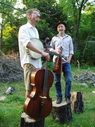 Folk musicians Fork and Knife pose with their instruments. Fork and Knife is an old-time duo featuring Pete Howard on fiddle and vocals; Matt Cartier on banjo, guitar, cello, vocals and as jig dancer. (Photo provided)