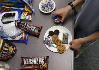 A participant selects items to create a dish during an Teen Iron Chef Chocolate Challenge at Belle Isle Library in Oklahoma City. Photo by Bryan Terry, The Oklahoman BRYAN TERRY - THE OKLAHOMAN