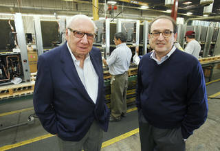 Jack Golsen, CEO (left) and Barry Golsen, Chairman of LSB Industries, stand in front of one of the assembly lines at ClimateMaster in Oklahoma City, OK, Monday, Oct. 17, 2011. By Paul Hellstern, The Oklahoman