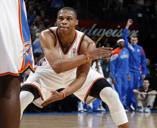 Oklahoma City's Russell Westbrook (0) reacts after hitting a shot at the end of the third quarter during the NBA basketball game between the Detroit Pistons and Oklahoma City Thunder at the Chesapeake Energy Arena in Oklahoma City, Monday, Jan. 23, 2012. Oklahoma City won, 99-79. Photo by Nate Billings, The Oklahoman