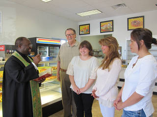 The Rev. Joseph Alsay, rector of St. Augustine of Canterbury Episcopal Church, performs a blessing ceremony at Daylight Donuts, 15001-A N May, as Robert Martin, Meg Hickey, Jayne Tennyson and Raven Khem look on. Photo by Carla Hinton, The Oklahoman