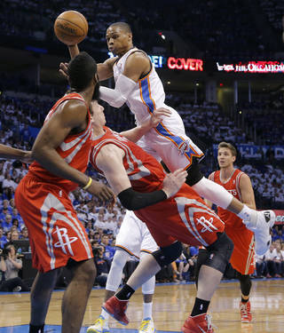 Oklahoma City's Russell Westbrook (0) goes over the top of Houston's Omer Asik (3) during Game 2 in the first round of the NBA playoffs between the Oklahoma City Thunder and the Houston Rockets at Chesapeake Energy Arena in Oklahoma City, Wednesday, April 24, 2013. Photo by Chris Landsberger, The Oklahoman