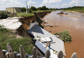 The smaller house on Gary and Rhonda Buford's property rests in the North Canadian River in Choctaw. Photo by Nate Billings, The Oklahoman NATE BILLINGS - NATE BILLINGS
