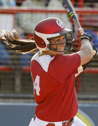 Oklahoma's Lauren Chamberlain drives in a run on a double in the third inning during a Women's College World Series game against California at ASA Hall of Fame Stadium in Oklahoma City, Friday, June 1, 2012. Photo by Bryan Terry, The Oklahoman