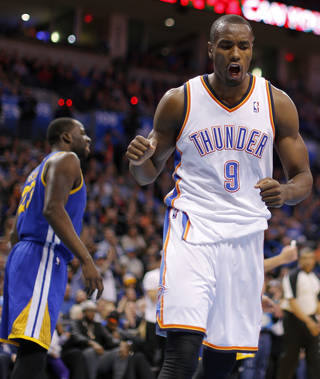 Oklahoma City's Serge Ibaka (9) reacts after making a basket and getting fouled during an NBA basketball game between the Oklahoma City Thunder and the Golden State Warriors at Chesapeake Energy Arena in Oklahoma City, Friday, Jan. 17, 2014. Photo by Bryan Terry, The Oklahoman