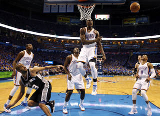 Oklahoma City's Serge Ibaka (9) reacts after blocking the shot of San Antonio's Tony Parker (9) in the second half during Game 3 of the Western Conference Finals in the NBA playoffs between the Oklahoma City Thunder and the San Antonio Spurs at Chesapeake Energy Arena in Oklahoma City, Sunday, May 25, 2014. Photo by Nate Billings, The Oklahoman