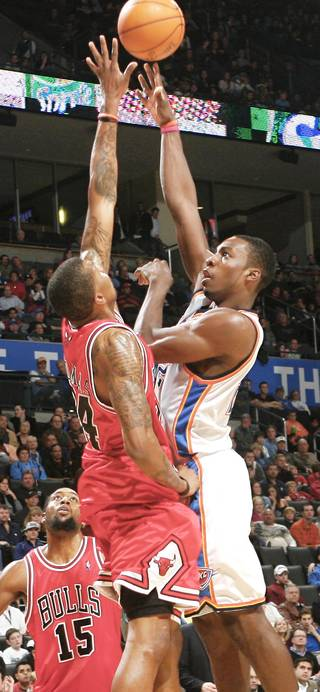 Chicago's Tyrus Thomas, left, defends on Oklahoma City's Jeff Green during the second half Wednesday at the Ford Center. Photo by Chris Landsberger, The Oklahoman