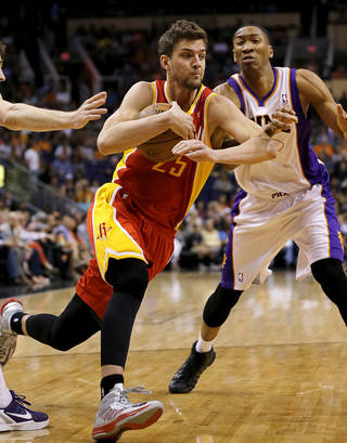 Houston Rockets' Chandler Parsons (25) drives past Phoenix Suns' Wesley Johnson during the first half of an NBA basketball game, Monday, April 15, 2013, in Phoenix. (AP Photo/Matt York) ORG XMIT: PNU110