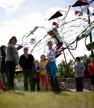 A crowd waits for the start of a carnival during the 2012 Guthrie 89er Day Celebration. Photo by Bryan Terry, The Oklahoman Archive BRYAN TERRY - THE OKLAHOMAN