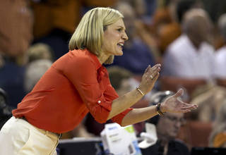 Texas head coach Karen Aston directs her team against Tennessee during an NCAA college basketball game at the Frank Erwin Center in Austin, Texas, on Sunday Dec. 16, 2012. Tennessee won 94-75. (AP Photo/Austin American-Statesman, Jay Janner)