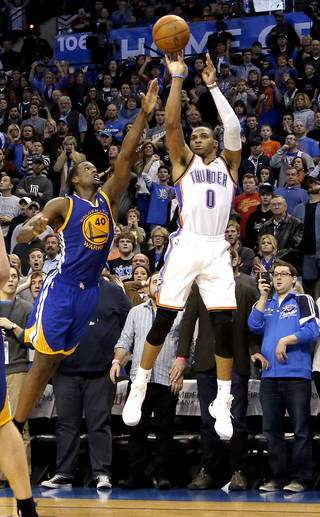 Oklahoma City's Russell Westbrook (0) shoots a game-winning three-point shot over Golden State's Harrison Barnes (40) during overtime of the during the NBA game between the Oklahoma City Thunder and the Golden State Warriors at the Chesapeake Energy Arena, Friday, Nov. 29, 2013. Photo by Sarah Phipps, The Oklahoman