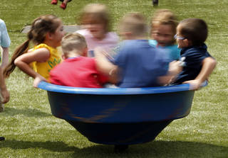 The two playgrounds at the new Early Childhood Center in Newcastle have artifiicial turf. Fitness for students as young as kindergarten will be emphasized as part of a nutrition and fitness grant awarded to the school district and partners in the community. Photo by Steve Sisney, The Oklahoman STEVE SISNEY - THE OKLAHOMAN