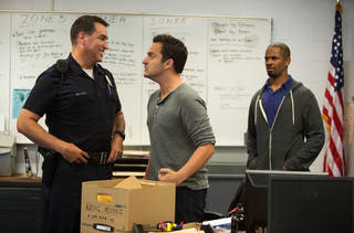 """Jake Johnson, center, as Ryan, makes an emphatic point to Rob Riggle as Segars, while Damon Wayans as Justin looks on in a scene from the film, """"Let's Be Cops."""" AP Photo/ Twentieth Century Fox Film Corp. Frank Masi, SMPSP - AP"""