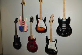 "The exhibit ""Starmaker: Jim Halsey and the Legends of Country Music"" features some of the signed guitars from Halsey's collection. From left, the guitars are from Aerosmith, Kenny Rogers, BB King, Bob Dylan and Carlos Santana. The exhibit is on view through May 18 atthe Gaylord-Pickens Oklahoma Heritage Museum. Photo by Captured Moments Photography"
