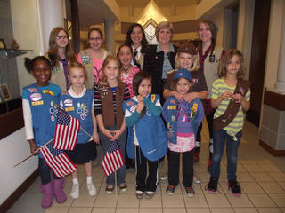 A group of Girl Scouts tours city hall with Norman Mayor Cindy Rosenthal, back row, second from left. PHOTO PROVIDED