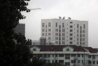 """The building housing """"Unit 61398"""" of the People's Liberation Army, center top, is seen on the outskirts of Shanghai, China. A U.S. security firm, Mandiant, said last year it traced attacks on American and other companies to the military unit in Shanghai. AP File Photo Uncredited - AP"""