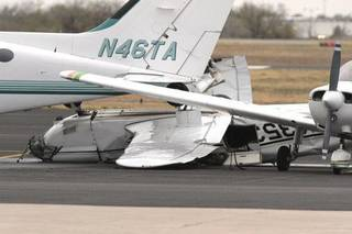 A crumpled airplane on the tarmac shows damage from Monday nights severe weather at Max Westheimer Airport on Tuesday, Nov. 8, 2011, in Norman, Okla. Photo by Steve Sisney, The Oklahoman ORG XMIT: KOD