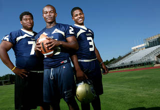 High school football players Markus Wakefield, Barry Sanders and Sterling Shepard (from left to right) pose at Heritage Hall High School, in Oklahoma City on Thursday, June 23, 2011. Photo by John Clanton, The Oklahoman ORG XMIT: KOD
