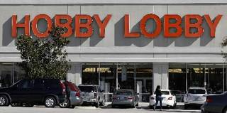 Customers walk to a Hobby Lobby store in Dallas on Thursday, Nov. 1, 2012. (AP Photo/Tony Gutierrez)