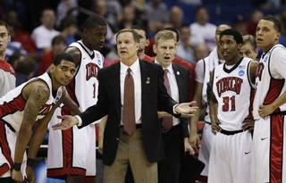UNIVERSITY OF NEVADA, LAS VEGAS / REACTION: UNLV head coach Lon Kruger and his team react during a break in action against Illinois in the second half of a Southwest Regional NCAA tournament second round college basketball game, Friday, March 18, 2011 in Tulsa, Okla. (AP Photo/Charlie Riedel) ORG XMIT: OKKJ178 Charlie Riedel - AP
