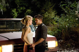"Taylor Schilling and Zac Efron star in ""The Lucky One."" Warner Bros. Photo"