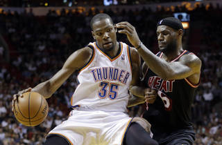 Miami Heat small forward LeBron James (6) puts pressure on Oklahoma City Thunder small forward Kevin Durant (35) during the fourth period of an NBA basketball game in Miami, Wednesday, Jan. 29, 2014. The Thunder won 112-95. (AP PhotoAlan Diaz)